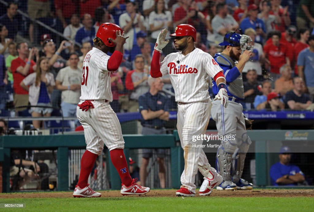 Carlos Santana #41 of the Philadelphia Phillies celebrates with Odubel Herrera #37 after hitting a two-run home run in the sixth inning during a game against the Toronto Blue Jays at Citizens Bank Park on May 25, 2018 in Philadelphia, Pennsylvania. The Blue Jays won 6-5.
