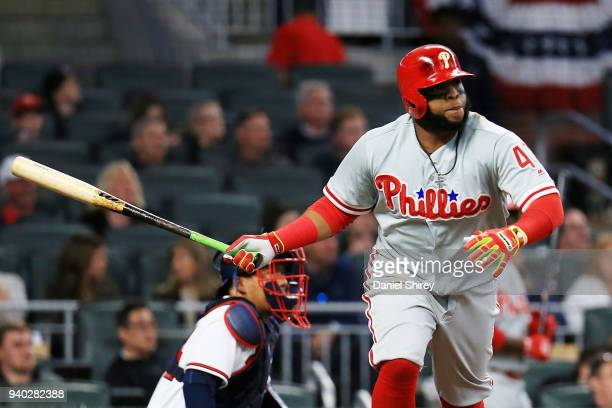 Carlos Santana of the Philadelphia Phillies drives in a run during the third inning against the Atlanta Braves at SunTrust Park on March 30 2018 in...