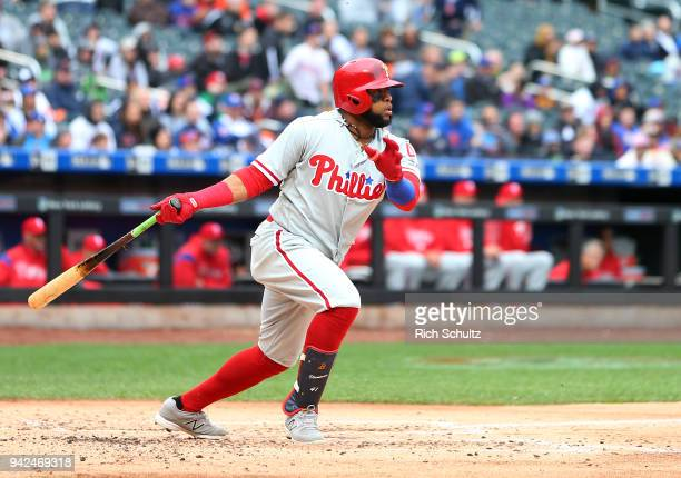 Carlos Santana of the Philadelphia Phillies hits a double during the third inning of a game against the New York Mets at Citi Field on April 4 2018...