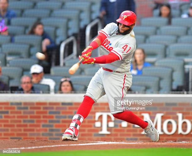 Carlos Santana of the Philadelphia Phillies hits a first inning double against the Atlanta Braves at SunTrust Park on March 31 2018 in Atlanta Georgia
