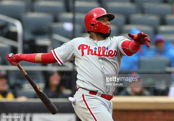 Carlos Santana of the Philadelphia Phillies hits a home run against the New York Mets during the ninth inning of a game at Citi Field on September 9...