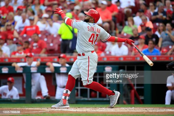 Carlos Santana of the Philadelphia Phillies hits a home run in the first inning against the Cincinnati Reds at Great American Ball Park on July 26...