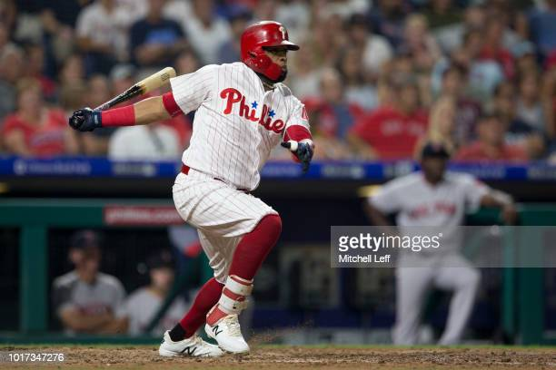 Carlos Santana of the Philadelphia Phillies hits a pinch hit RBI single in the bottom of the fourth inning against the Boston Red Sox at Citizens...