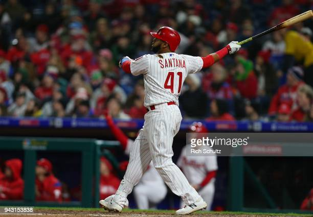 Carlos Santana of the Philadelphia Phillies hits a threerun home run during the fourth inning of a game against the Miami Marlins at Citizens Bank...