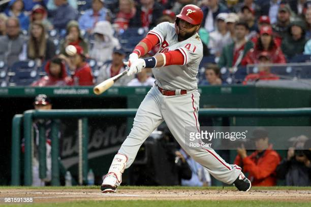 Carlos Santana of the Philadelphia Phillies hits a two RBI single in the first inning against the Philadelphia Phillies at Nationals Park on June 22...