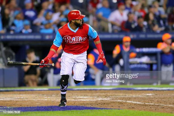 Carlos Santana of the Philadelphia Phillies hits a tworun home run in the sixth inning during the 2018 Little League Classic against the New York...
