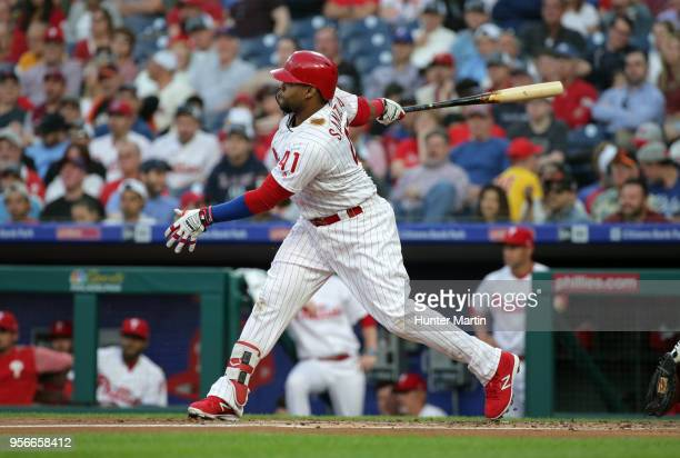 Carlos Santana of the Philadelphia Phillies hits an RBI double in the first inning during a game against the San Francisco Giants at Citizens Bank...
