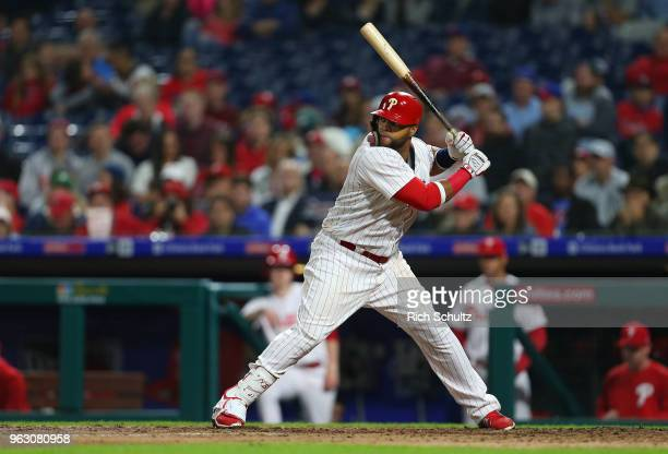 Carlos Santana of the Philadelphia Phillies in action against the Atlanta Braves during a game at Citizens Bank Park on May 22 2018 in Philadelphia...