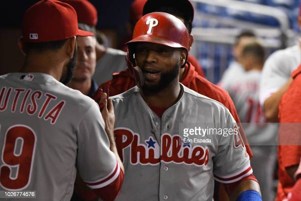 Carlos Santana of the Philadelphia Phillies is congratulated by Jose Bautista after hitting a home run in the first inning against the Miami Marlins...