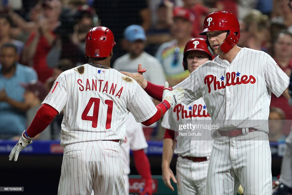 Carlos Santana #41 of the Philadelphia Phillies is congratulated by Rhys Hoskins #17 after hitting a two-run home run against the Washington Nationals during the seventh inning of a game at Citizens Bank Park on June 29, 2018 in Philadelphia, Pennsylvania. The Nationals defeated the Phillies 17-7.