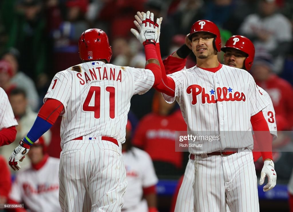 Carlos Santana #41 of the Philadelphia Phillies is congratulated by Vince Velasquez #28 after he hit a three-run home run during the fourth inning of a game against the Miami Marlins at Citizens Bank Park on April 7, 2018 in Philadelphia, Pennsylvania.