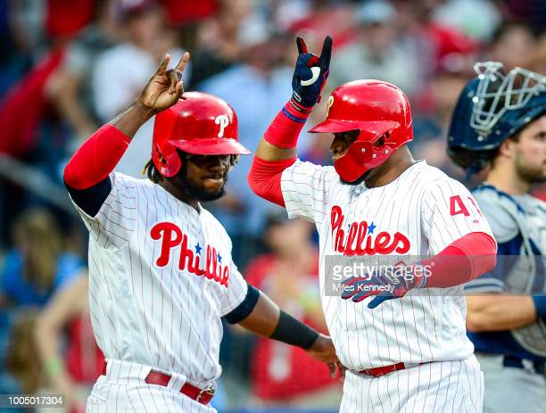 Carlos Santana of the Philadelphia Phillies is greeted at home plate by Odubel Herrera after hitting a threerun home run against San Diego Padres...