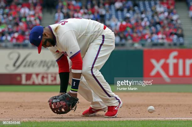 Carlos Santana of the Philadelphia Phillies misplays a ground ball for an error in the sixth inning during a game against the Atlanta Braves at...