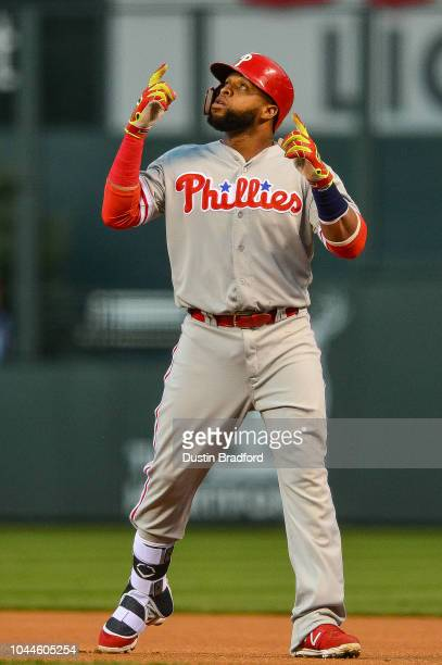 Carlos Santana of the Philadelphia Phillies points to the sky after hitting a single against the Colorado Rockies in the first inning of a game at...