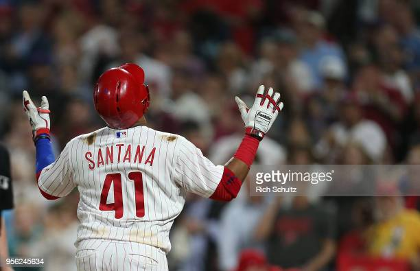 Carlos Santana of the Philadelphia Phillies reacts after hitting a home run against the San Francisco Giants during the sixth inning of a game at...