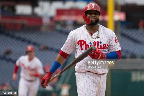 Carlos Santana of the Philadelphia Phillies reacts after striking out to end the bottom of the first inning against the Washington Nationals in game...