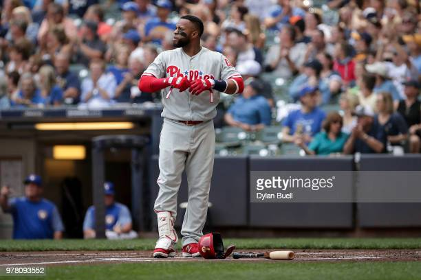 Carlos Santana of the Philadelphia Phillies reacts after striking out in the first inning against the Milwaukee Brewers at Miller Park on June 16...