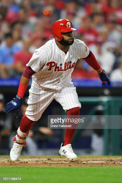 Carlos Santana of the Philadelphia Phillies runs to first on a single in the third inning against the Miami Marlins at Citizens Bank Park on August 4...