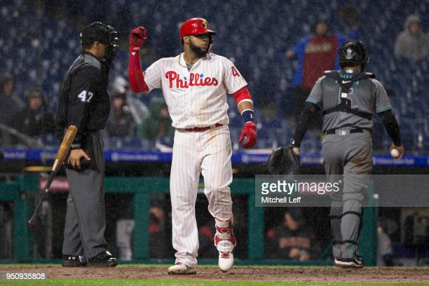 Carlos Santana of the Philadelphia Phillies tosses his bat after striking out to end the bottom of the sixth inning against the Arizona Diamondbacks...