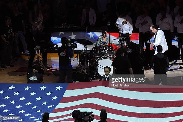 Carlos Santana performs during the national anthem before the Golden State Warriors face the Cleveland Cavaliers for Game Two of the 2016 NBA Finals...