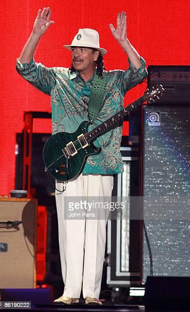 Carlos Santana performs onstage with Mana at the 2009 Billboard Latin Music Awards at Bank United Center on April 23 2009 in Miami Florida