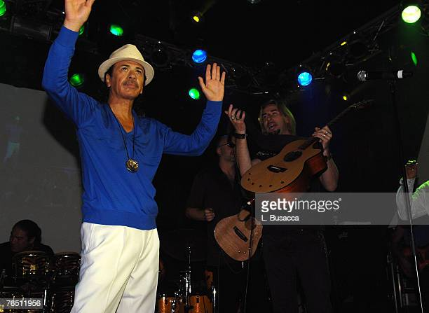 Carlos Santana performs with Chad Kroeger of Nickelback during an intimate evening with Carlos Santana to benefit the Milagro Foundation at the...