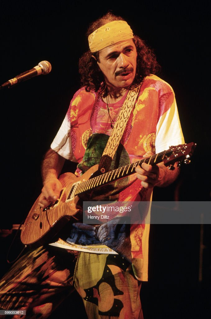 carlos santana playing the guitar news photo getty images. Black Bedroom Furniture Sets. Home Design Ideas