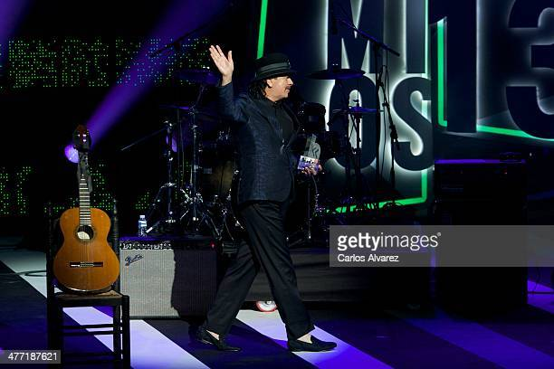 Carlos Santana receives the Cadena Dial award during the Cadena Dial 2013 awards ceremony at the Miguel Delibes auditorium on March 7 2014 in...