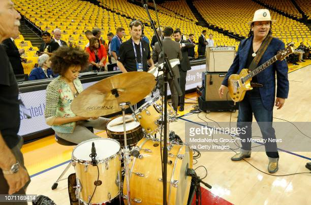 Carlos Santana right and his wife Cindy Blackman Santana do their national anthem sound check before the Golden State Warriors take on the Cleveland...