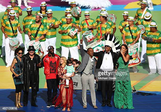 Carlos Santana Wyclef Jean Shakira with her son Milan Pique Alexandre Pires Carlinhos Brown and Ivete Sangalo look on during the Opening Ceremony...