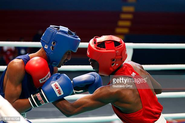 Carlos Santos of Brazil fights with Jose Zarraga of Venezuela during the Men's 49kg Boxing Finals as part of the I ODESUR South American Youth Games...