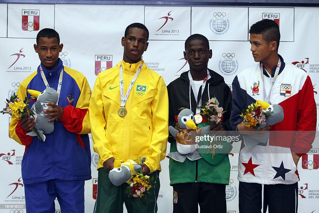 Carlos Santos of Brazil (gold), Jose Zarraga of Venezuela (Silver) Rafael Pedroza of Panama and Tefon Greene of Guayana (bronze) in the podium of Boxing 49kg category as part of the I ODESUR South American Youth Games at Coliseo Miguel Grau on September 25, 2013 in Lima, Peru.