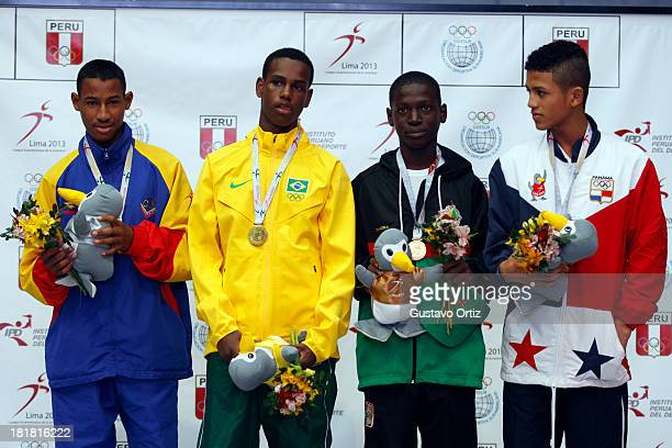 Carlos Santos of Brazil Jose Zarraga of Venezuela Rafael Pedroza of Panama and Tefon Greene of Guayana in the podium of Boxing 49kg category as part...
