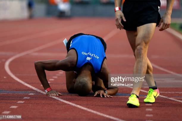 Carlos Santos of Brazil kneels to the track after finishing second in his section of the men's 1500 meter run on the first day of the 61st Mt SAC...