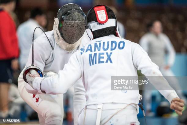 Carlos Sanudo of Mexico LoupYann Ferre of Canada in the Junior Men's Epee competition at the Cadet and Junior PanAmerican Fencing Championships on...