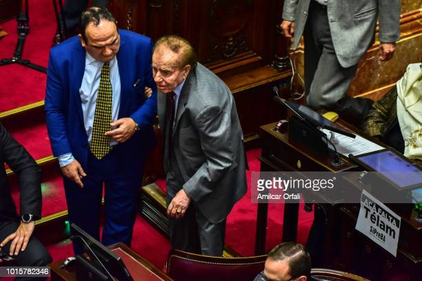 Carlos Saul Menem Senator for La Rioja looks on while senators vote for the new abortion law on August 8 2018 in Buenos Aires Argentina The bill aims...