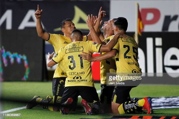 Carlos Sebastian Ferreira of Morelia celebrates with teammates after scoring the second goal of his team during the 11th round match between Morelia...