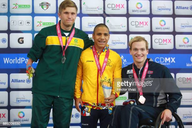 Carlos Serrano of Colombia Gold Medal Christian Sadie of South Africa Silver Medal and Andreas Bjornstad Bronze Medal pose after men's 200 m...