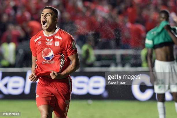 Carlos Sierra of America celebrates after scoring the first goal of his team during the match between America de Cali and Deportivo Cali as part of...