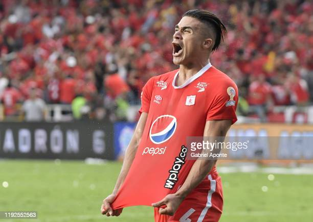 Michael Rangel of America celebrates the first goal of his team scored by an own goal of Sebastian Viera of Junior during the second leg final match...