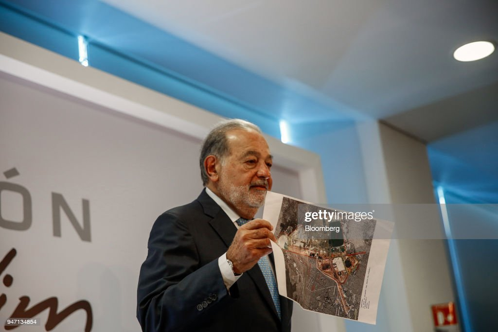 Carlos Slim, chairman emeritus of America Movil SAB, holds up an image of the New International Airport of Mexico City (NAICM) during a press conference in Mexico City, Mexico, on Monday, April 16, 2018. Slim said that Mexico has plenty of advantages in the NAFTA negotiations. Photographer: Alejandro Cegarra/Bloomberg via Getty Images