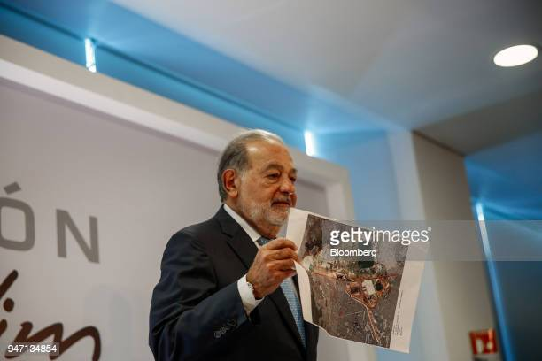 Carlos Slim chairman emeritus of America Movil SAB holds up an image of the New International Airport of Mexico City during a press conference in...