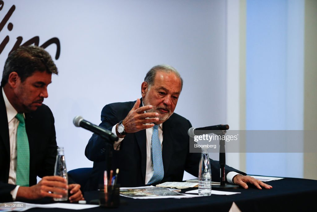 Carlos Slim, chairman emeritus of America Movil SAB, right, speaks during a press conference in Mexico City, Mexico, on Monday, April 16, 2018. Slim said that Mexico has plenty of advantages in the NAFTA negotiations. Photographer: Alejandro Cegarra/Bloomberg via Getty Images