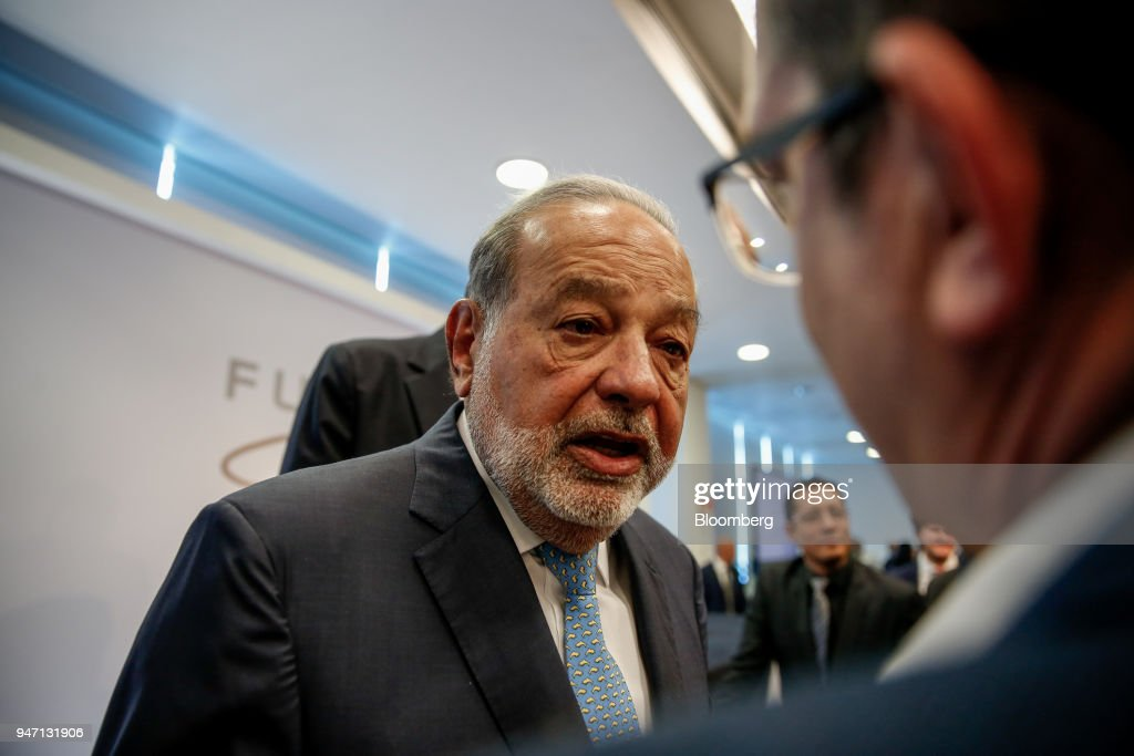 Carlos Slim, chairman emeritus of America Movil SAB, speaks with an attendee during a press conference in Mexico City, Mexico, on Monday, April 16, 2018. Slim said that Mexico has plenty of advantages in the NAFTA negotiations. Photographer: Alejandro Cegarra/Bloomberg via Getty Images