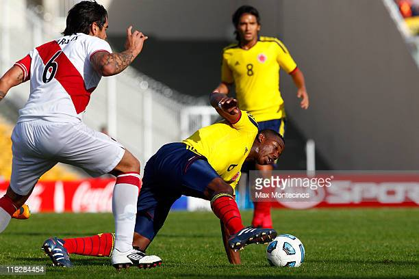 Carlos Sánchez from Colombia fights for the ball with Juan Vargas from Peru During a quarter final match between Colombia and Peru at Mario Alberto...