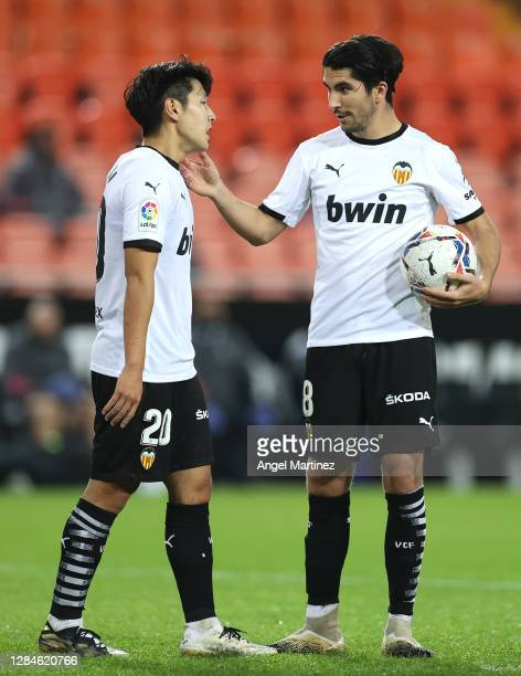 Carlos Soler and Lee Kang-In of Valencia talk during the La Liga Santander match between Valencia CF and Real Madrid at Estadio Mestalla on November...