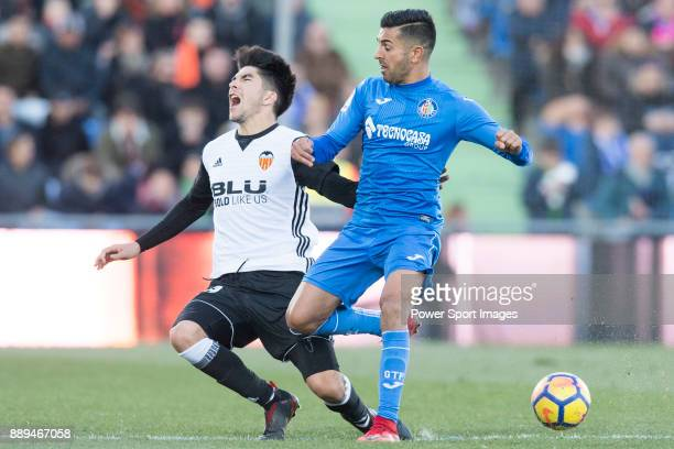 Carlos Soler Barragan of Valencia CF in action against Francisco Molinero Calderon of Getafe CF during the La Liga 201718 match between Getafe CF and...