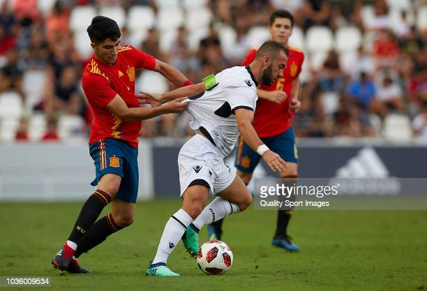 Carlos Soler of Spain competes for the ball with Keidi Bare of Albania during the 2019 UEFA Under 21 qualifier match between Spain U21 and Albania...