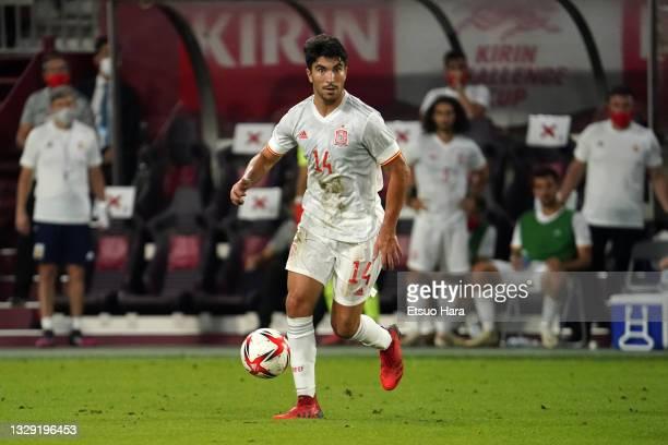 Carlos Soler of Spain in action during the U-24 international friendly match between Japan and Spain at the Noevir Stadium Kobe on July 17, 2021 in...