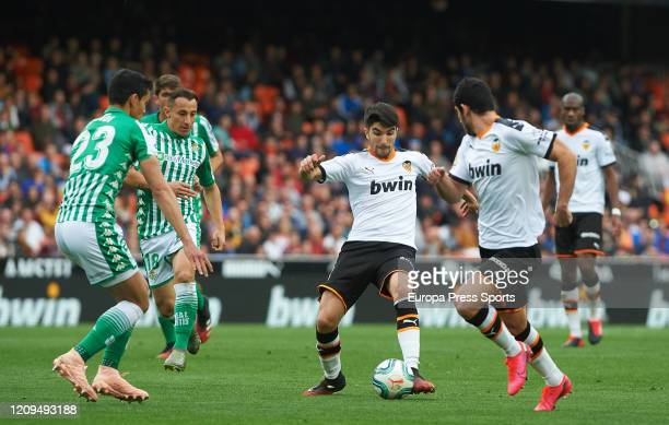 Carlos Soler of Valencia and Aissa Mandi of Real Betis in action during the Spanish League La Liga football match played between Valencia CF and Real...